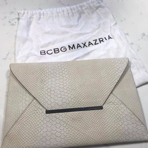 BCBG snake skin leather clutch